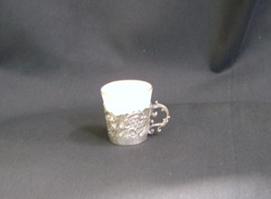 Small cup with silver base